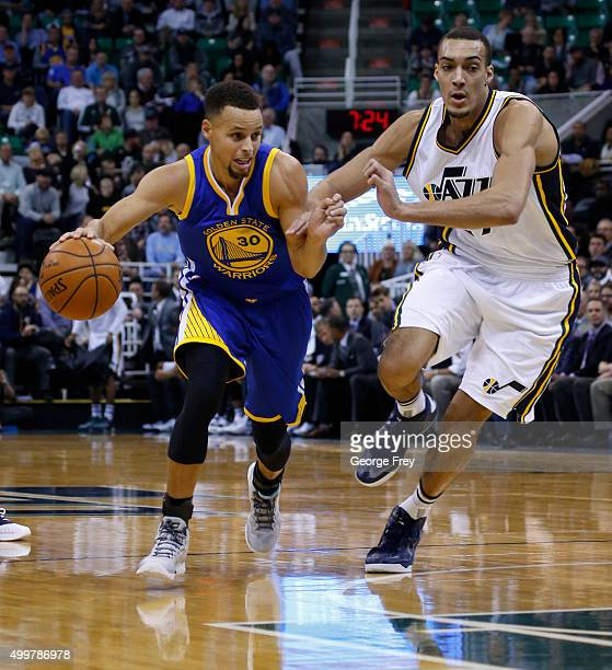 Guard Stephen Curry of the Golden State Warriors drives on Utah Jazz center Rudy Gobert during a game against the Utah Jazz during the first half of...