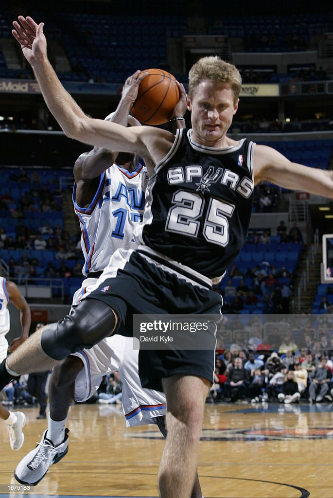 Guard Steve Kerr #25 of the San Antonio Spurs looses his balance while guard Smoosh Parker #17 of the Cleveland Cavaliers gets a rebound during the game at Gund Arena on November 16, 2002 in Cleveland, Ohio. The Spurs won 90-77.