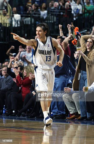 Guard Steve Nash of the Dallas Mavericks celebrates against the Toronto Raptors during the game at American Airlines Center on December 2 2002 in...