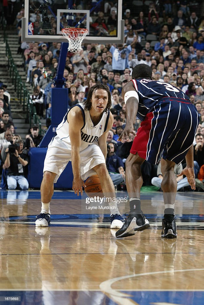Guard Steve Nash #13 of the Dallas Mavericks dribbles against guard Steve Francis #3 of the Houston Rockets during the game at American Airlines Center on November 21, 2002 in Dallas, Texas. The Mavericks won 103-90.