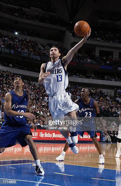 Guard Steve Nash of the Dallas Mavericks shoots against guards Tyronn Lue and Michael Jordan of the Washington Wizards during the game at American...