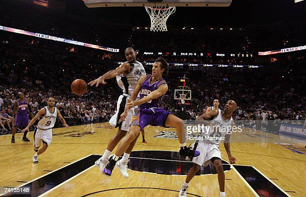 Guard Steve Nash of the Phoenix Suns moves the ball against Tim Duncan of the San Antonio Spurs in Game Three of the Western Conference Semifinals...