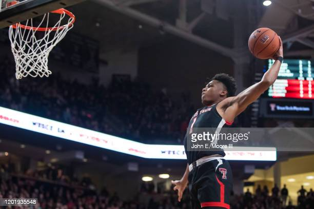 Guard Terrence Shannon Jr. #1 of the Texas Tech Red Raiders dunks the ball during the first half of the college basketball game against the Kentucky...