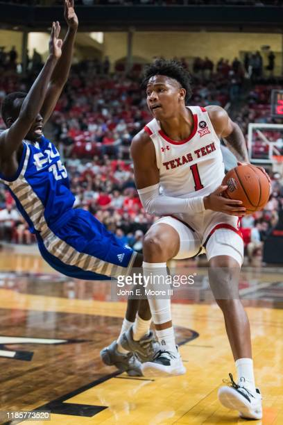 Guard Terrence Shannon of the Texas Tech Red Raiders drives against guard Deang Deang of the Eastern Illinois Panthers during the first half of the...