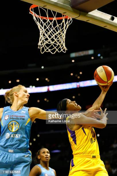 Guard Tierra RuffinPratt of the Los Angeles Sparks goes up for a shot as guard Allie Quigley of the Chicago Sky attempts to block during the second...