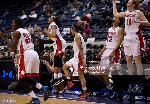 Guard Tiffany Johnson guard Celeste Edwards guard Amber Deane center Jodie ComelieSigmundova and forward Ally Mallot of the Dayton Flyers celebrate...