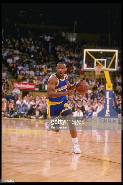 Guard Tim Hardaway of the Golden State Warriors drives the ball down the court Mandatory Credit Ken Levine /Allsport