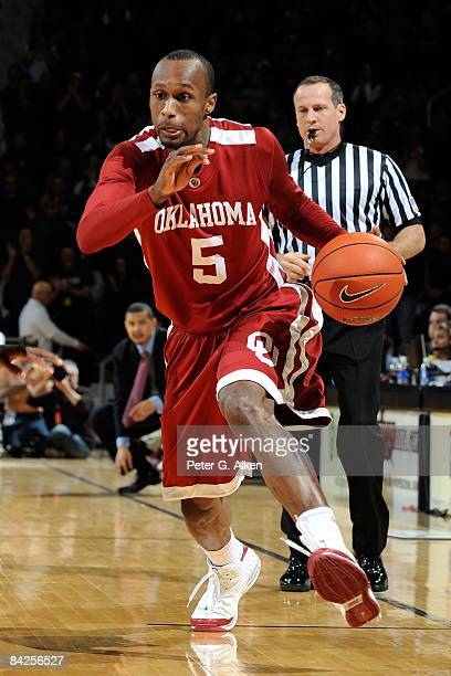 Guard Tony Crocker of the Oklahoma Sooners drives the ball up court against the Kansas State Wildcats during the first half on January 10 2009 at...