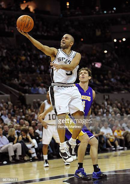 Guard Tony Parker of the San Antonio Spurs takes a shot against Luke Walton of the Los Angeles Lakers on January 12 2010 at ATT Center in San Antonio...