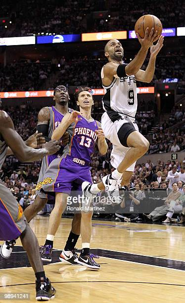 Guard Tony Parker of the San Antonio Spurs takes a shot against Steve Nash of the Phoenix Suns in Game Four of the Western Conference Semifinals...
