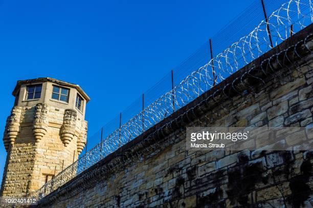 guard tower on prison walls - 刑事司法 ストックフォトと画像