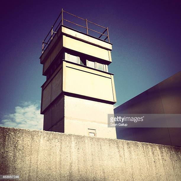 A guard tower stands at a stillstanding portion of the Berlin Wall at the Bernauer Strasse memorial on the 53rd anniversary of the construction of...