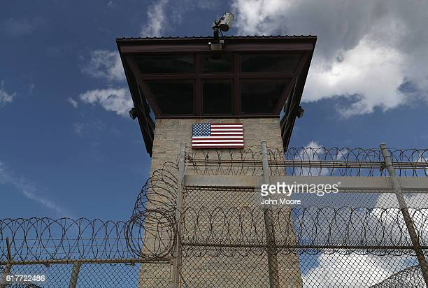 "Guard tower stands at the entrance of the U.S. Prison at Guantanamo Bay, also known as ""Gitmo"" on October 23, 2016 at the U.S. Naval Station at..."