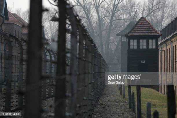 Guard towers and barbed wire fences stand at the Auschwitz I memorial concentration camp site on February 15 2019 in Oswiecim Poland Next year will...