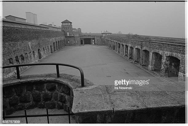 Guard towers and barracks surround the prisoner courtyard at Mauthausen a Nazi concentration camp in operation during World War II Over 100000...