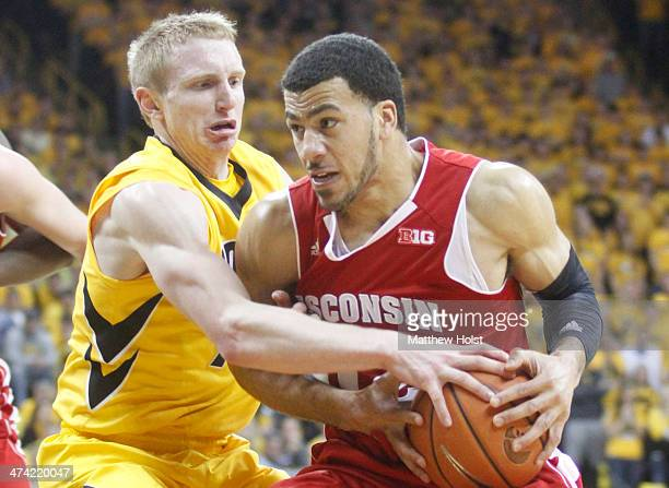 Guard Traevon Jackson of the Wisconsin Badgers fights to keep tha ball away during the first half from guard Mike Gesll of the Iowa Hawkeyes on...