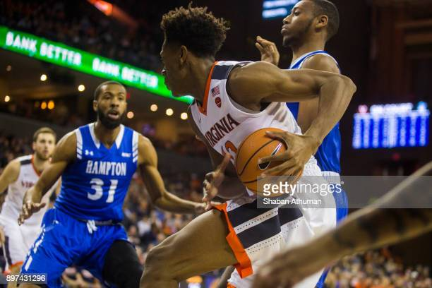 Guard Trevon Gross Jr #10 of the University of Virginia Cavalier looks to pass in a game against Hampton Univeristy at John Paul Jones Arena on...