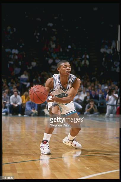 Guard Tyrone Bogues of the Charlotte Hornets in action with the ball during a game at the Charlotte Coliseum in Charlotte North Carolina Mandatory...