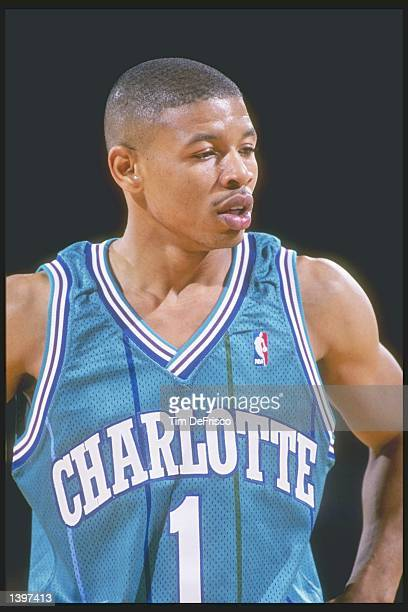 Guard Tyrone Bogues of the Charlotte Hornets stands on the court during a game against the Denver Nuggets at the McNichols Sports Arena in Denver...