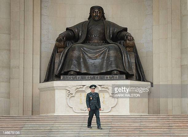 A guard walks down a set of stairs in front of the Genghis Khan statue at the Parliament Building of Mongolia in Ulan Bator on June 22 2012...