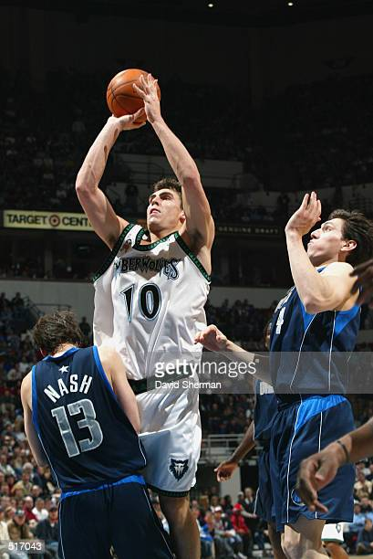Guard Wally Szczerbiak of the Minnesota Timberwolves shoots over point guard Steve Nash of the Dallas Mavericks during game three of the Western...