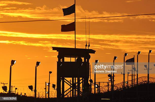 BAY A guard watches over Camp Delta prison where Canadian Omar Khadr is detained Oct 24 2010