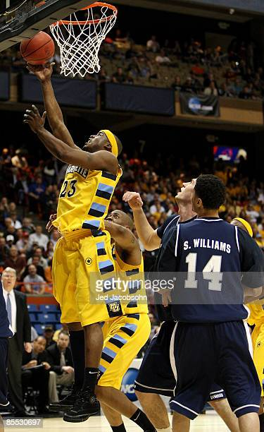Guard Wesley Matthews of the Marquette Golden Eagles goes for a layup against the Utah State Aggies during the first round of the NCAA Division I...