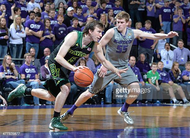 Guard Will Spradling of the Kansas State Wildcats pressures guard Brady Heslip of the Baylor Bears during the second half on March 8 2014 at Bramlage...