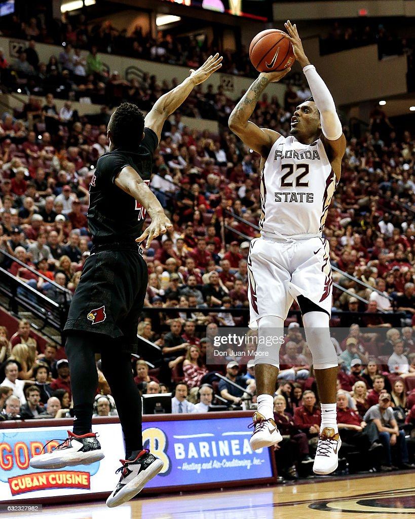 Guard Xavier Rathan-Mayes #22 of the Florida State Seminoles shoots over Guard Donovan Mitchell #45 the Louisville Cardinals at the Donald L. Tucker Center on January 21, 2017 in Tallahassee, Florida. The 10th ranked Seminoles defeated the 12th ranked Cardinals 73 to 68.