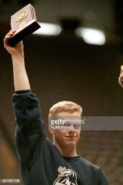 Guard Young of Brigham Young University mounts the award platform for the Vault event during the 2000 NCAA Photos via Getty Images Men's Division 1...