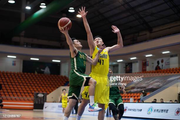 Guard YuAn Chiang made a layup shot during the Super Basketball League match between Jeoutai Technology and Taiwan Beer at Banqiao Stadium on March...