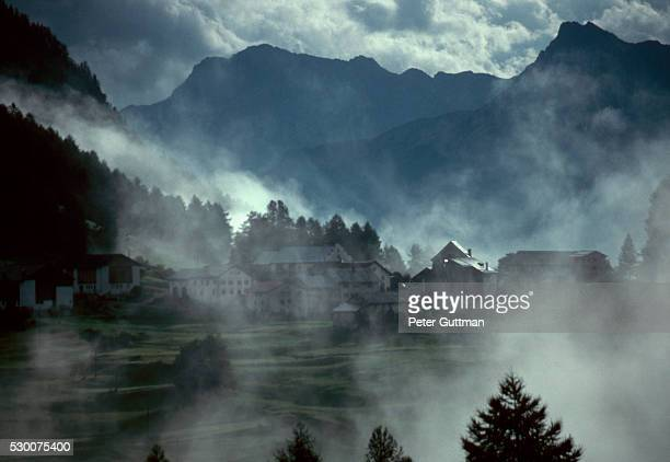 guarda in mist - guarda switzerland stock pictures, royalty-free photos & images