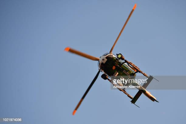 Guardia Civil Eurocopter 145 Helicopter flies over the border fence separating the Spanish exclave of Ceuta from Morocco on August 23 2018 in Ceuta...