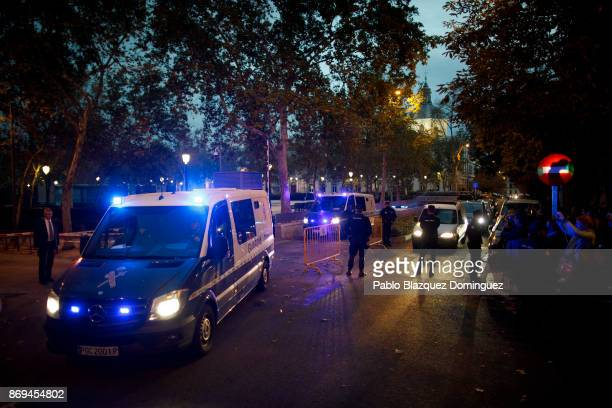 Guardia Civil prisoners transport vans leave Spain's National High Court after a judge gave orders to send nine ceased members of the Catalan...