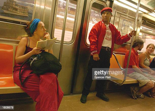 Guardian Angel keeps watch on a subway August 12, 2001 in New York City. Started in 1979 by Curtis Sliwa, the Guardian Angels were originally a...