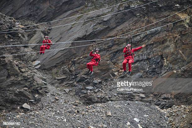 Guardian journalist Steve Morris and other visitors using one of the three long Zip World Titan wires located at the Llechwedd Slate Caverns Blaenau...