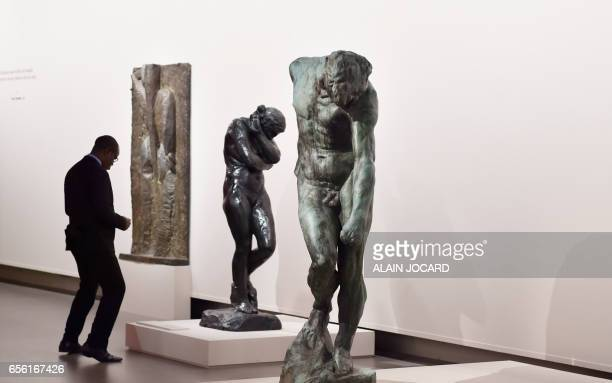 A guardian stands near sculptures by French sculptor Auguste Rodin on March 21 at the Grand Palais in Paris during an exhibition on the occasion of...