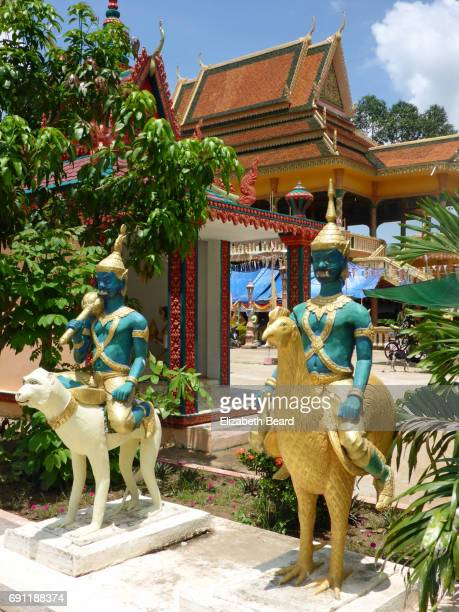 Guardian statues riding a chicken and monkey, Koh Dach pagoda, Cambodia