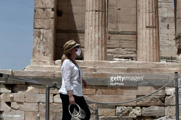 Guardian wearing a mask at the archaeological site of the Acropolis hill in Athens on Monday May 18, 2020. Greece, which has contained the spread of...