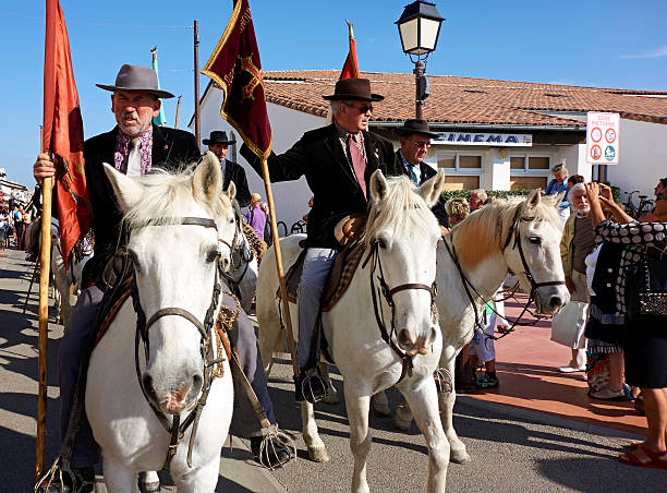 418c1144257 Guardians of the Camargue in a religious procession in Saintes Marie de la  Mer. The