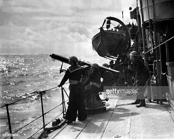 Guarding our Convoys. Men aboard a destroyer on escort duty fire warning shots to unidentified aircraft by 2-pounder Pom Pom. April 1940 P011667