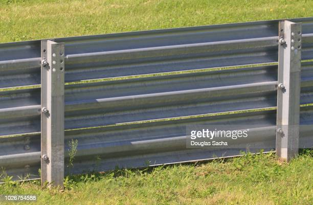 guardrail type caar barrier fence along the highway - transportation building type of building stock photos and pictures