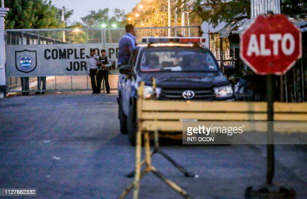 Guards and police officers stand outside Jorge Navarro prison known as The Model in Tipitapa Managua on February 26 2019 Mothers of alleged political...