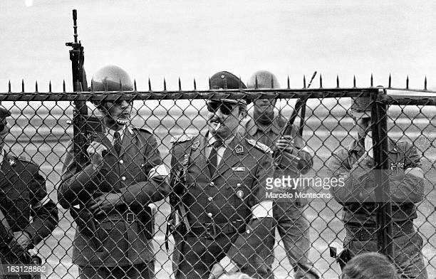 Guards at the National Stadium where thousands were imprisoned in Santiago Chile shortly after the coup in september, 1973.