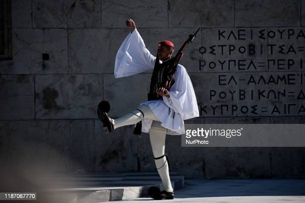 Guards at the Unknown Soldier monument front of the Greek Parliament, during the changing of the guard at the Syntagma square on December 8, 2019 in...