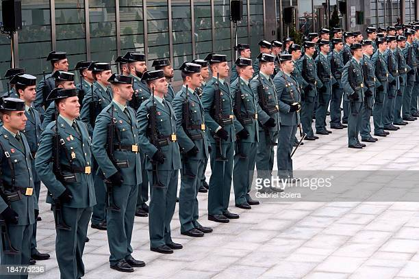 Guards attend a ceremony for the opening of the Civil Guard's Maritime Coastal Monitoring And Borders centre on October 16 2013 in Madrid Spain