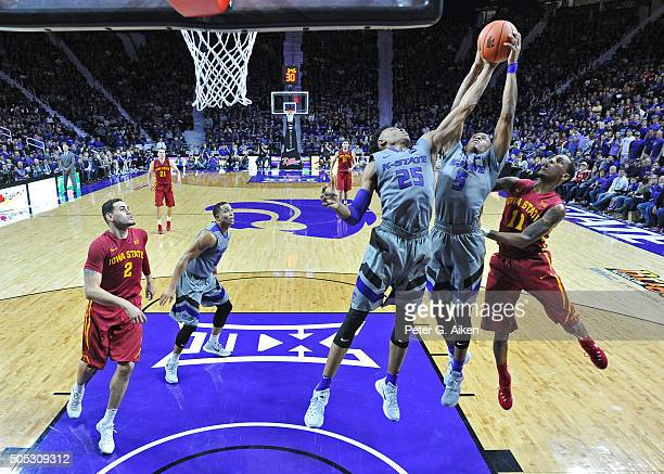 Guards Barry Brown and Wesley Iwundu of the Kansas State Wildcats go up for a rebound against guard Monte Morris of the Iowa State Cyclones during...