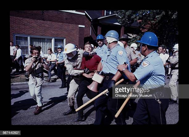 Guards carrying away a demonstrator during a civil rights march Cicero Illinois 1966
