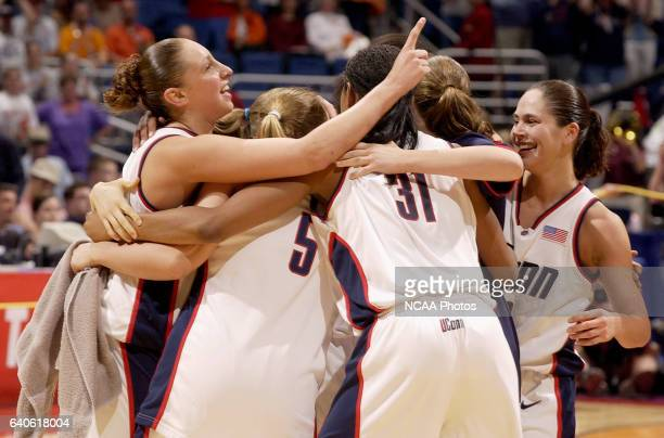 UCONN guards Diana Taurasi and Sue Bird join the celebration after defeating the University of Oklahoma during the Division 1 Women's Basketball...