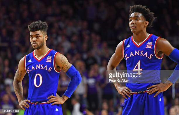 Guards Frank Mason III and Devonte Graham of the Kansas Jayhawks look on during a foul shot against the Kansas State Wildcats during the first half...